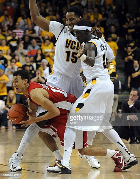 Western Kentucky guard Brandon Harris tries to escape a double team by Virginia Commonwealth University forward Juvonte Reddic and guard Briante...