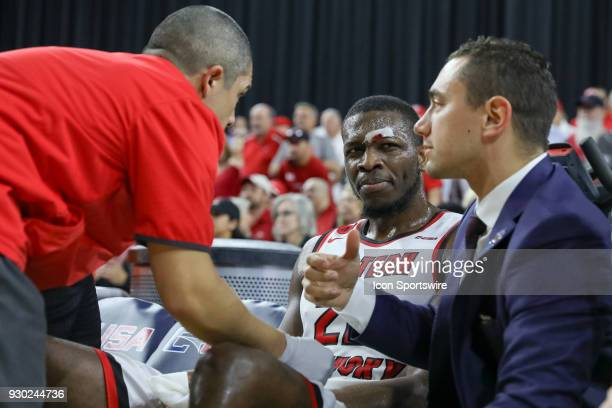 Western Kentucky Hilltoppers forward Dwight Coleby has his head examined during the Conference USA Basketball Championship game between the Western...
