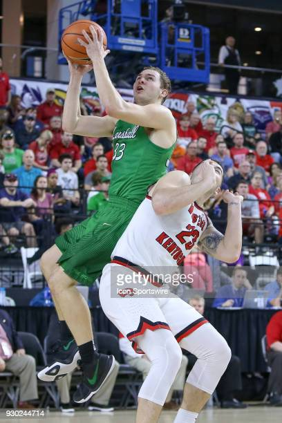 Western Kentucky Hilltoppers forward Justin Johnson is called for the foul against Marshall Thundering Herd guard Jon Elmore during the Conference...