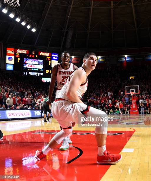Western Kentucky Hilltoppers forward Justin Johnson looks to the crowd after a big slam late during the second half between Marshall Thundering Herd...