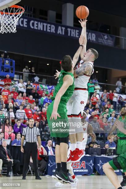 Western Kentucky Hilltoppers forward Justin Johnson shoots over Marshall Thundering Herd forward Ajdin Penava during the Conference USA Basketball...