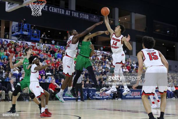 Western Kentucky Hilltoppers forward Marek Nelson swats away a pass attempt from Marshall Thundering Herd guard CJ Burks during the Conference USA...