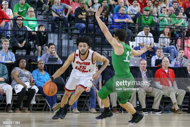 Western Kentucky Hilltoppers guard Darius Thompson drives around Marshall Thundering Herd guard Jarrod West during the Conference USA Basketball...
