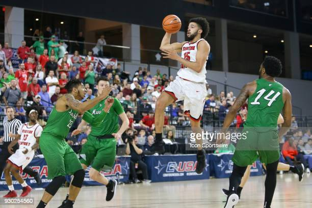 Western Kentucky Hilltoppers guard Darius Thompson switches hands while going to the basket during the Conference USA Basketball Championship game...