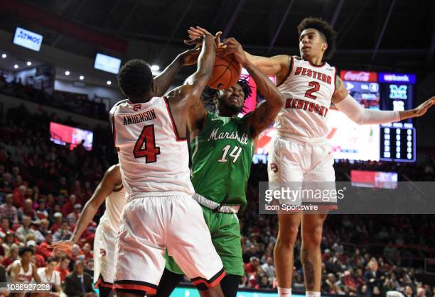 Western Kentucky Hilltoppers guard Jared Savage and guard Josh Anderson blocks the shot of Marshall Thundering Herd guard CJ Burks during a college...