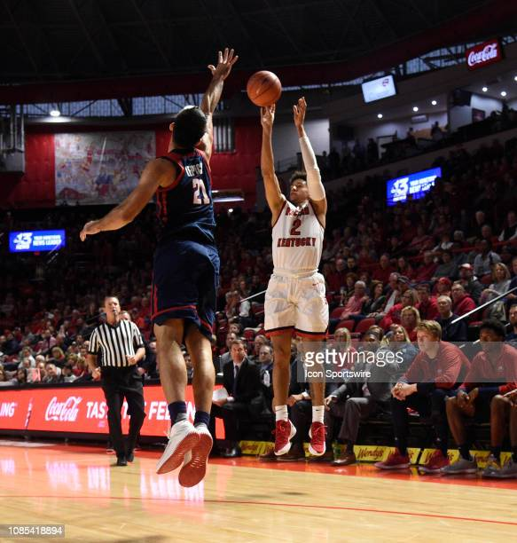Western Kentucky Hilltoppers guard Jared Savage knocks down a three over Florida Atlantic Owls forward Simeon Lepichev during a college basketball...