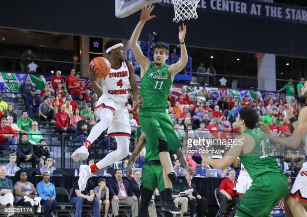 Western Kentucky Hilltoppers guard Josh Anderson looks for an outlet pass with Marshall Thundering Herd forward Ajdin Penava defending during the...