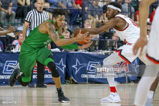 Western Kentucky Hilltoppers guard Josh Anderson strips the ball away from Marshall Thundering Herd guard Rondale Watson during the Conference USA...