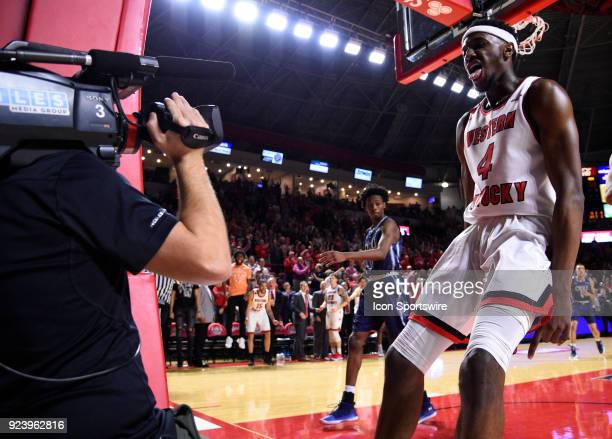 Western Kentucky Hilltoppers guard Josh Anderson yells to the camera after a big slam dunk during the second half between the Old Dominion Monarch...