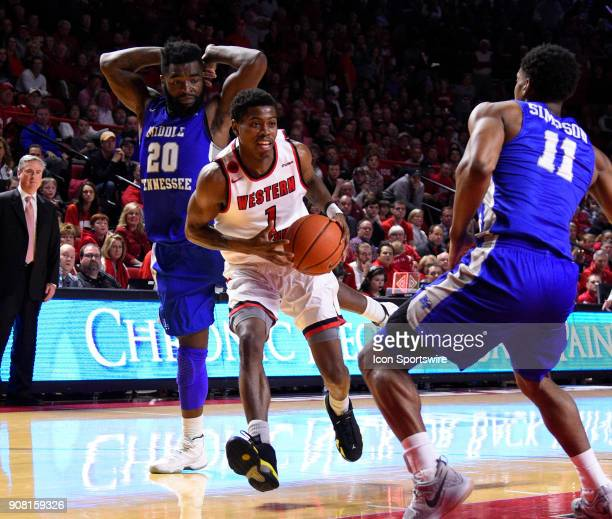 Western Kentucky Hilltoppers guard Lamonte Bearden dribbles past Middle Tennessee Blue Raiders guard Giddy Potts and guard Edward Simpson during the...