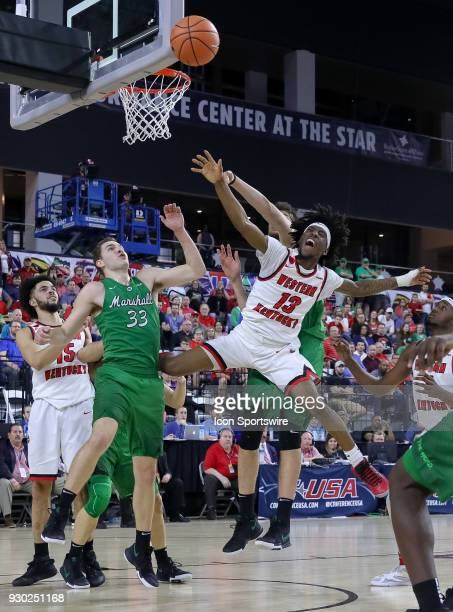 Western Kentucky Hilltoppers guard Taveion Hollingsworth goes up for a shot during the Conference USA Basketball Championship game between the...