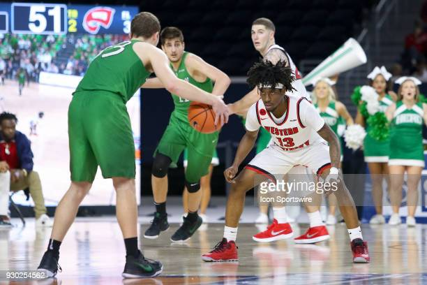 Western Kentucky Hilltoppers guard Taveion Hollingsworth guards Marshall Thundering Herd guard Jon Elmore during the Conference USA Basketball...