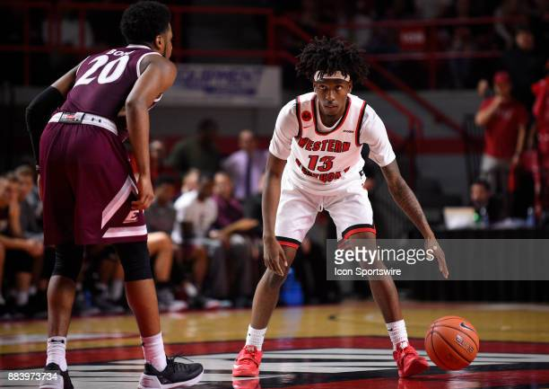 Western Kentucky Hilltoppers guard Taveion Hollingsworth looks at the play clock as he dribbles during the second half on Wednesday Nov 29 2017 at...