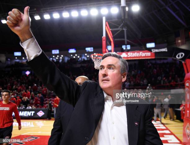 Western Kentucky Hilltoppers head coach Rick Stansberry holds a thumbs up to the crowd as he walks off the court during second half of the first...
