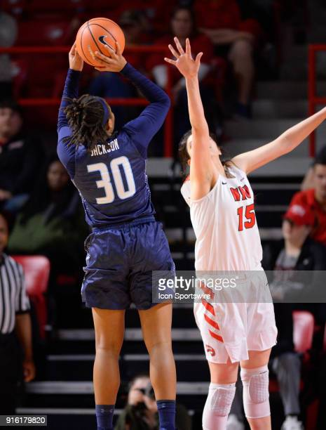 Western Kentucky Lady Toppers center Raneem Elgedawy tries to block the shot of Old Dominion Lady Monarchs guard Ashley Jackson during the third...
