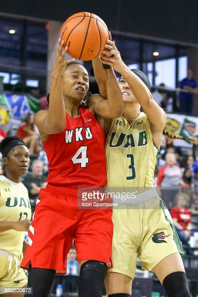 Western Kentucky Lady Toppers forward Dee Givens and UAB Blazers guard Angela Vendrell fight for a rebound during the Conference USA Women's...