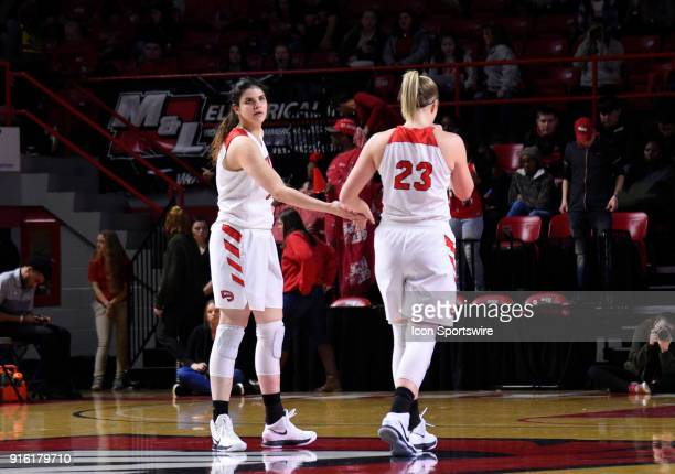 Western Kentucky Lady Toppers forward Ivy Brown and Western Kentucky Lady Toppers center Raneem Elgedawy slap hands as they walk down the court...