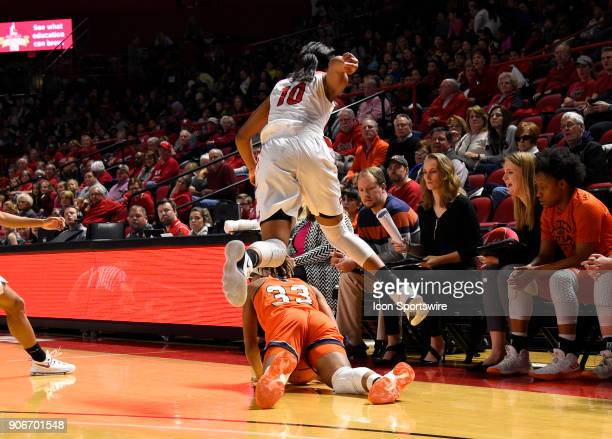 Western Kentucky Lady Toppers forward Tashia Brown and UTSA Roadrunners guard Barbara Benson chase after the loose ball during the first period...