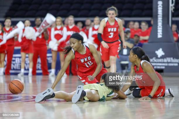 Western Kentucky Lady Toppers forward Tashia Brown battles with UAB Blazers guard Miyah Barnes for a loose ball during the Conference USA Women's...