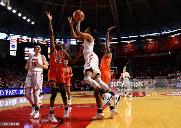 Western Kentucky Lady Toppers forward Tashia Brown drives the ball and shoots over UTSA Roadrunners forward Tija Hawkins during the first period...
