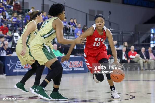 Western Kentucky Lady Toppers forward Tashia Brown drives the lane during the Conference USA Women's Basketball Championship game between the Western...