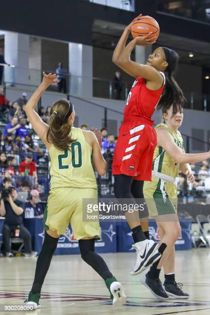 Western Kentucky Lady Toppers forward Tashia Brown shoots over UAB Blazers guard Deanna Kuzmanic during the Conference USA Women's Basketball...