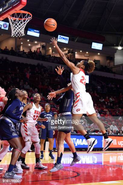 Western Kentucky Lady Toppers guard Sherry Porter shoots a lay up over Old Dominion Lady Monarchs guard Taylor Edwards during the third period of the...