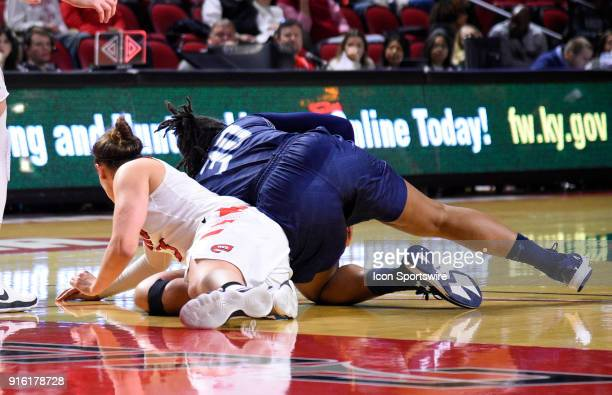 Western Kentucky Lady Toppers guard Sidnee Bopp and Old Dominion Lady Monarchs guard Ashley Jackson fight for the loose ball during the first period...