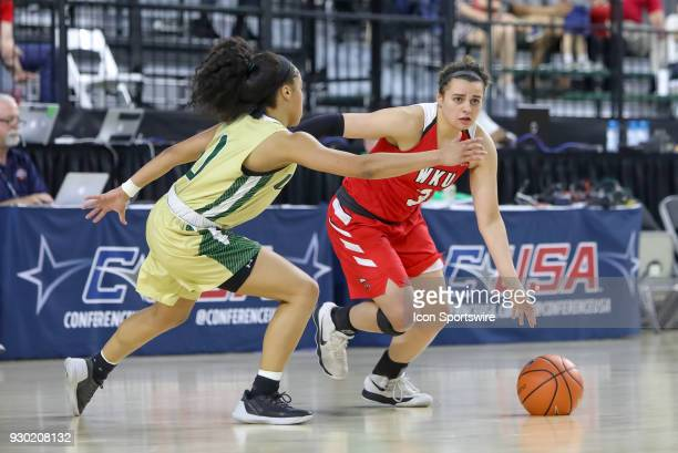 Western Kentucky Lady Toppers guard Sidnee Bopp dribbles around UAB Blazers guard Miyah Barnes during the Conference USA Women's Basketball...