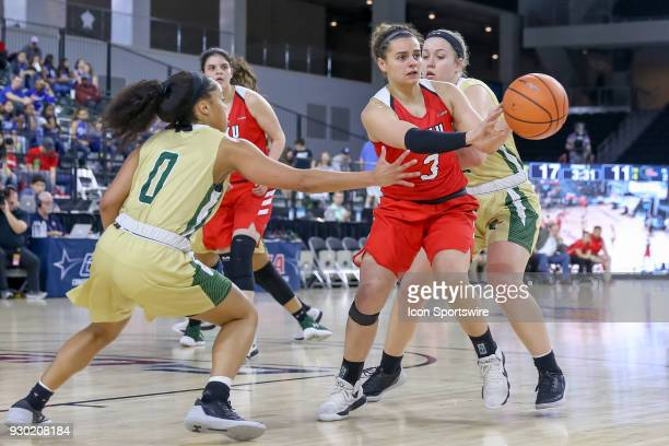 Western Kentucky Lady Toppers guard Sidnee Bopp kicks the ball out wide during the Conference USA Women's Basketball Championship game between the...