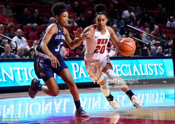 Western Kentucky Lady Toppers guard Terri Smith drives the lane past Old Dominion Lady Monarchs guard Victoria Morris during the fourth period of the...