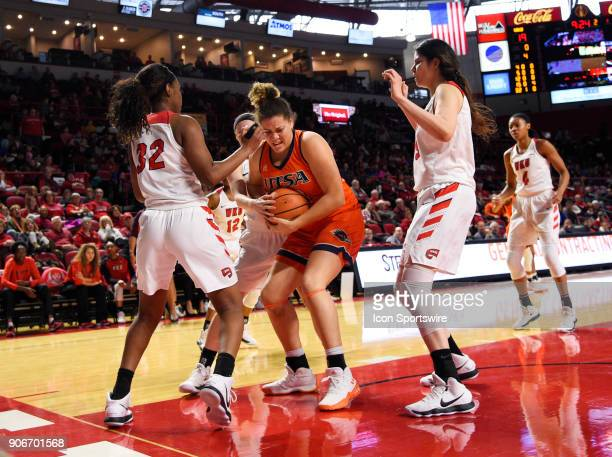 Western Kentucky Lady Toppers guard Whitney Creech and UTSA Roadrunners center Billie Marlow fight for the loose ball during the third period during...