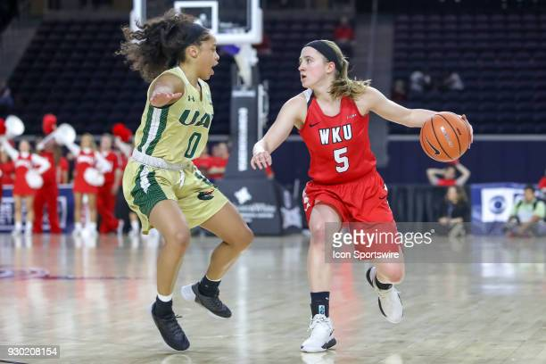 Western Kentucky Lady Toppers guard Whitney Creech is defended by UAB Blazers guard Miyah Barnes during the Conference USA Women's Basketball...