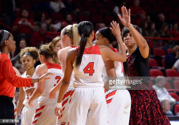 Western Kentucky Lady Toppers head coach Michelle ClarkHeard gives forward Dee Givens a high five during the second period of the Old Dominion Lady...