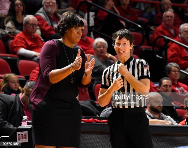 Western Kentucky Lady Toppers head coach Michelle ClarkHeard talks with the referee during the third period during the women's college basketball...