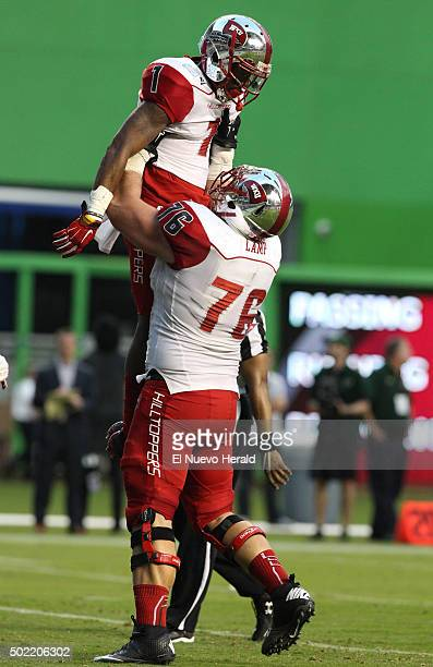 Western Kentucky wide receiver Nacarius Fant is lifted by Forrest Lamp as they celebrate Fant's touchdown during the third quarter of the Miami Beach...