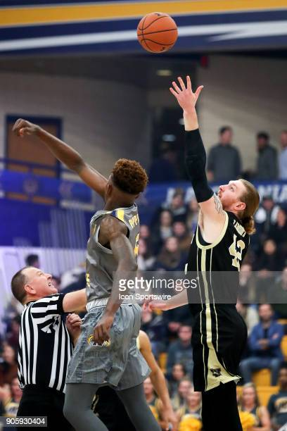Western Michigan Broncos center Drake LaMont wins the opening tip against Kent State Golden Flashes forward Danny Pippen during the first half of the...