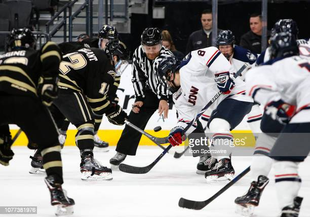 Western Michigan Broncos forward Cole Gallant and Connecticut Huskies forward Carter Turnbull face off during the Ice Vegas Invitational Friday, Jan....