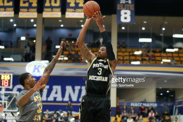 Western Michigan Broncos guard/forward Josh Davis shoots over Kent State Golden Flashes guard Desmond Ridenour during the first half of the men's...