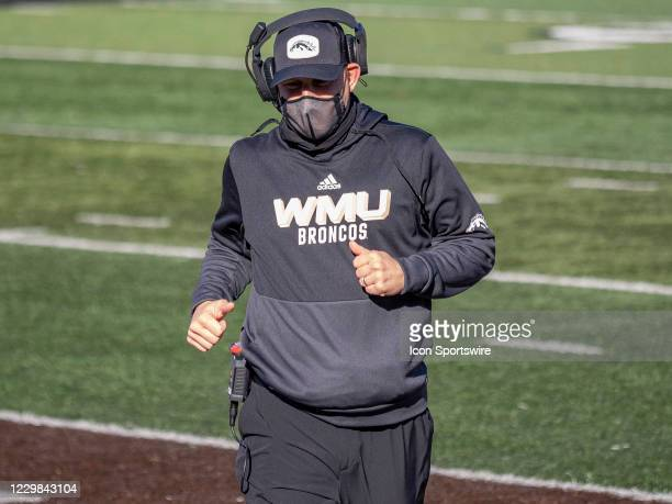 Western Michigan Broncos head coach Tim Lester runs out on the field to check on an injured Western Michigan Broncos player during the college...