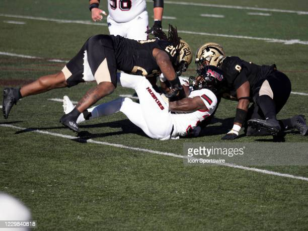 Western Michigan Broncos linebacker Corvin Moment makes a stop during the college football game between the Northern Illinois Huskies and Western...