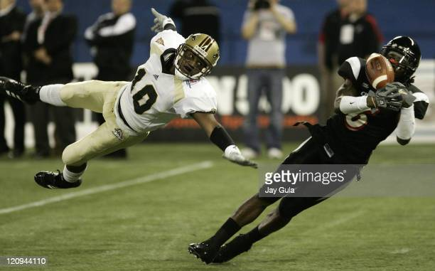 Western Michigan Broncos receiver Joe Chapple dove for this pass but it was out of his reach and almost intercepted by Cincinnati Bearcats defensive...