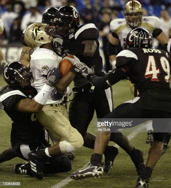 Western Michigan Broncos running back Brandon West is gang tackled by Cincinnati Bearcats defenders in the International Bowl at Rogers Centre in...
