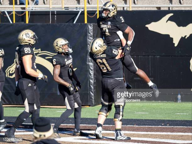 Western Michigan Broncos running back La'Darius Jefferson celebrates a touchdown with his teammate Western Michigan Broncos offensive guard Mike...