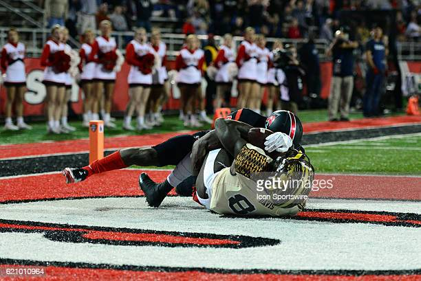 Western Michigan Broncos Wide Receiver Corey Davis and Ball State Cardinals Safety Corey Hall fight for the pass during the MidAmerican Conference...