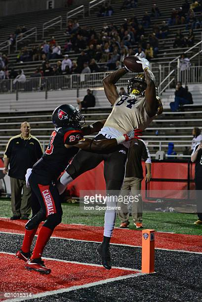 Western Michigan Broncos Wide Receiver Corey Davis and Ball State Cardinals Corner Back Marc Walton go up for a catch in the end zone during the...