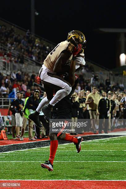 Western Michigan Broncos Wide Receiver Corey Davis brings down the ball over Ball State Cardinals Safety Corey Hall during the MidAmerican Conference...