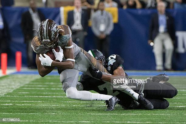 Western Michigan Broncos wide receiver Corey Davis is tackled by Ohio Bobcats safety Toran Davis after a long gain during the MAC Championship...