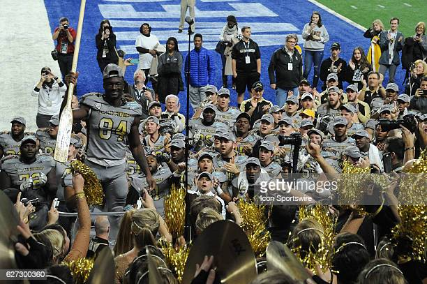 Western Michigan Broncos wide receiver Corey Davis leads the band in the playing of the fight song following the Western Michigan Broncos 2923...