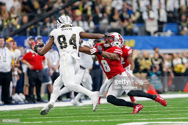 Western Michigan Broncos wide receiver Corey Davis stiff arms Wisconsin Badgers cornerback Sojourn Shelton during the Goodyear Cotton Bowl Classic...
